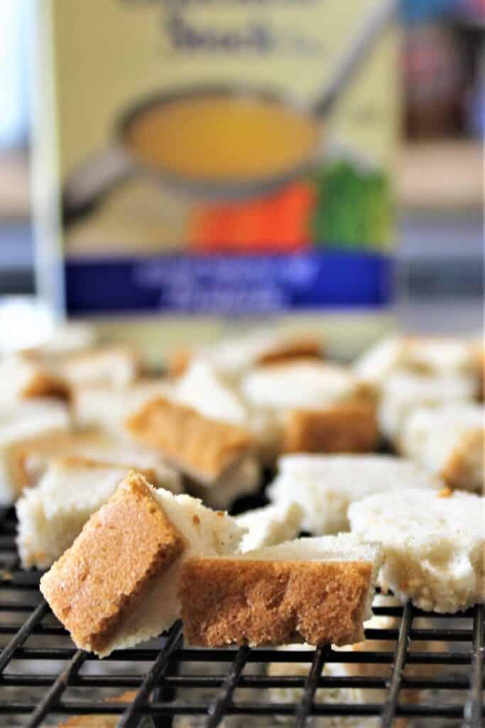 dried cubes of gluten free bread on racks