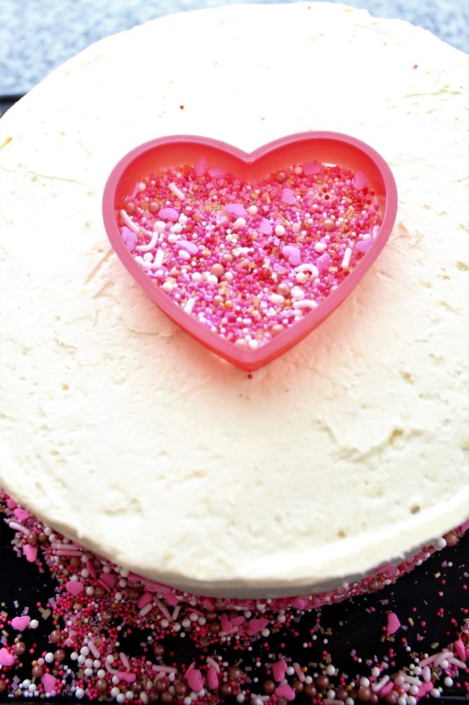 heart shaped cookie cutter filled with sprinkles