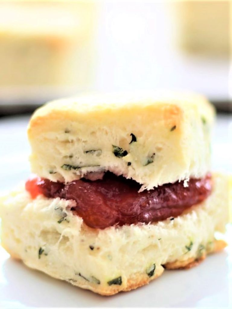 basil cream biscuit cut open and stuffed with strawberry jam