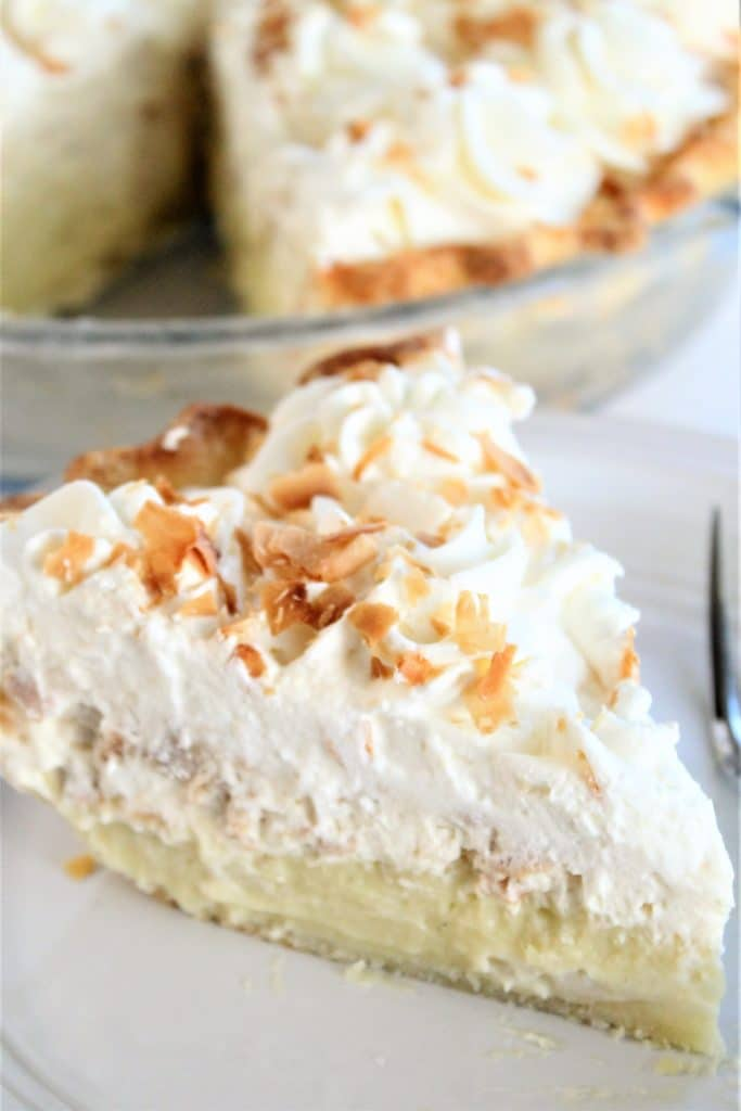 triple layer gluten free coconut cream pie slice