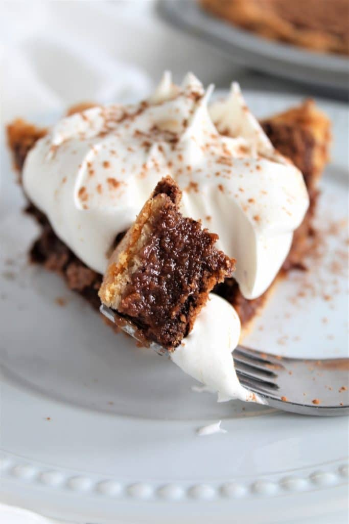 forkful of gluten free chocolate chess pie on plate