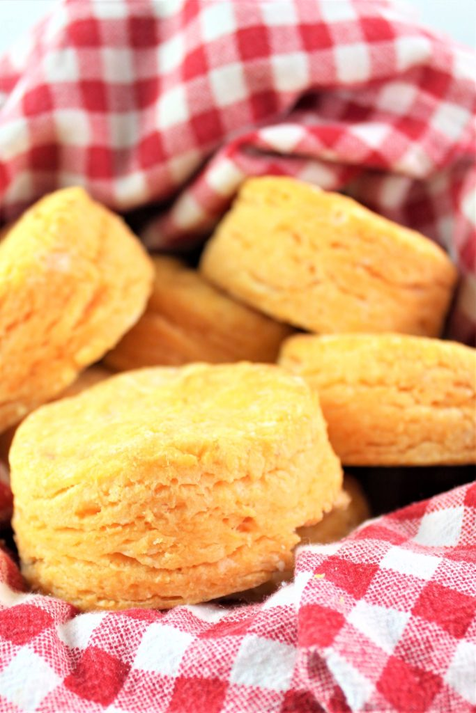 sweet potato biscuits in red checked basket