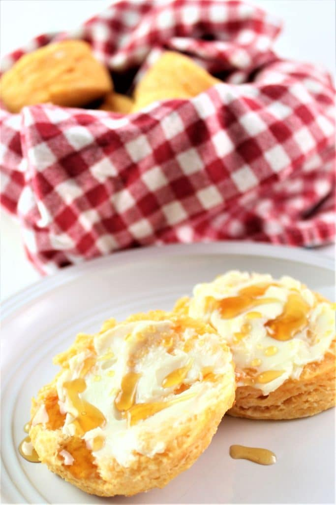 split open biscuit with butter and honey
