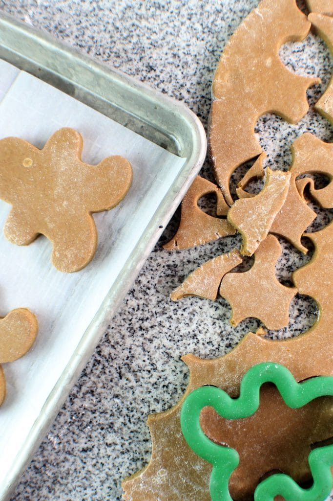 cutting out the gingerbread cookies