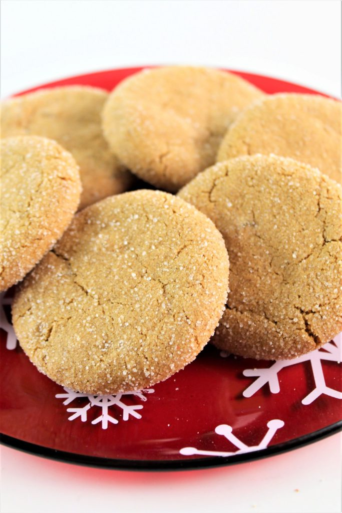 ultimate gluten free ginger cookies on a red snowflake plate