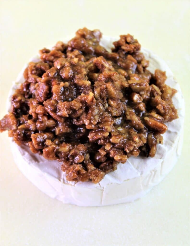 praline mixture set atop wheel of brie on puff pastry