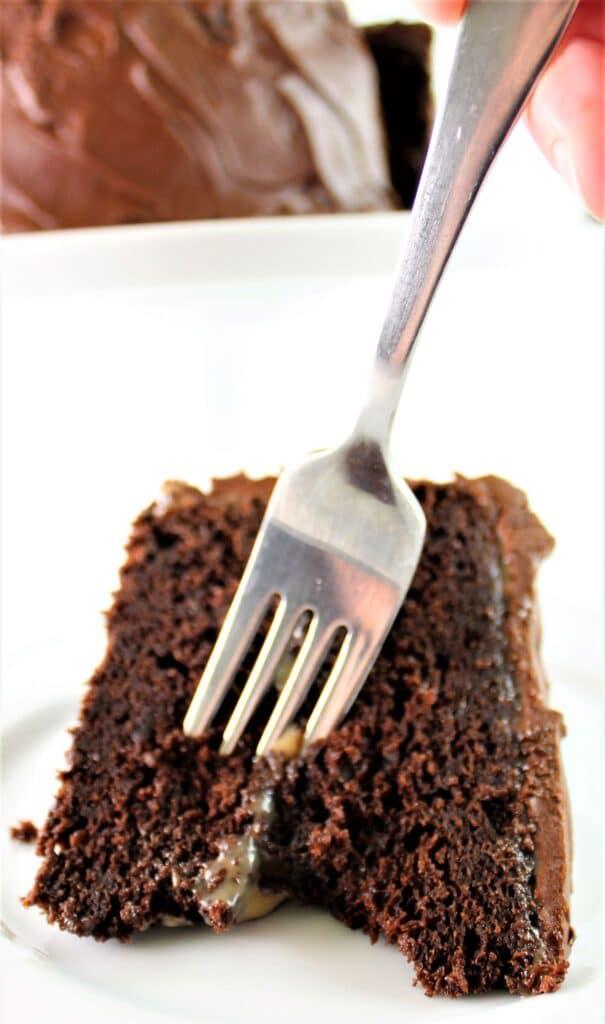 digging into a piece of chocolate caramel cake