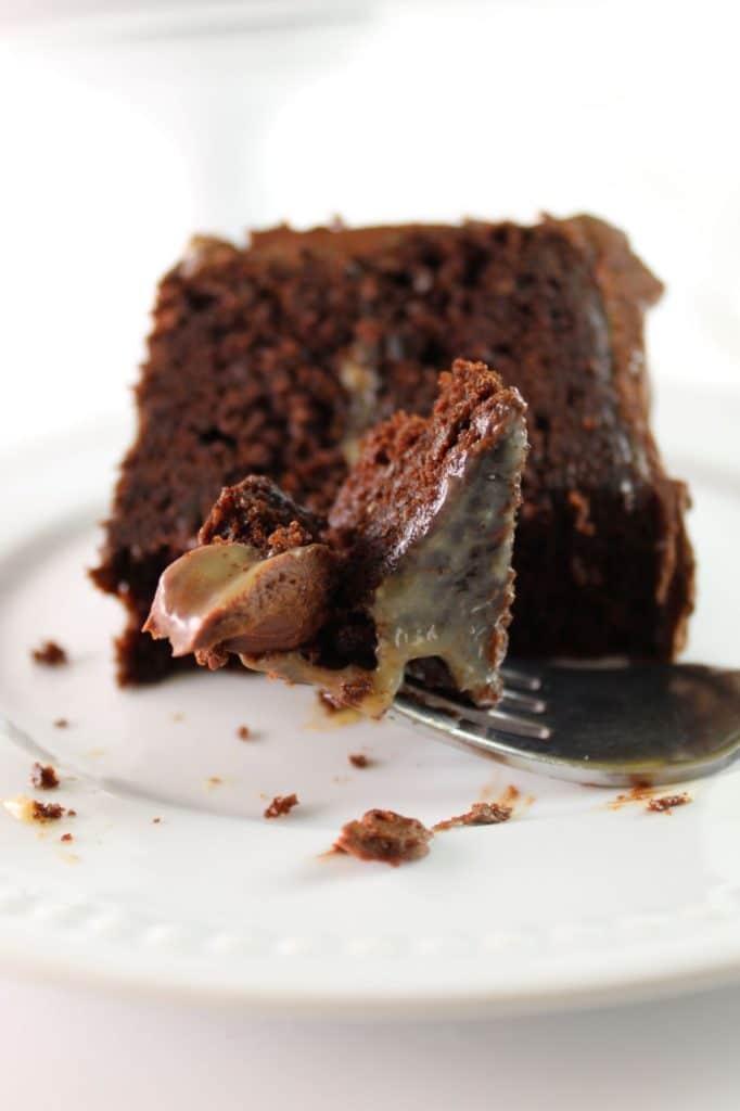 fork full of chocolate caramel cake