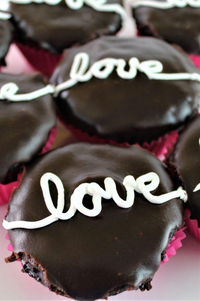 love written on several gluten free hostess cupcakes