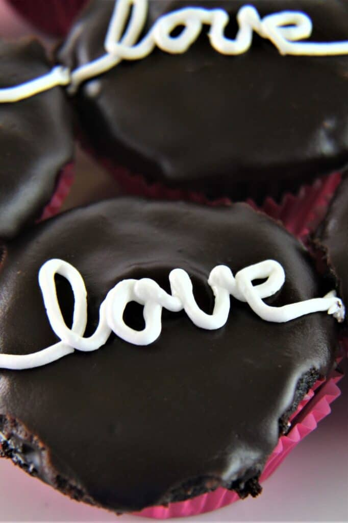 gluten free hostess cupcakes with love written on the top
