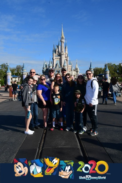 disney 2020 family pic in front of the castle