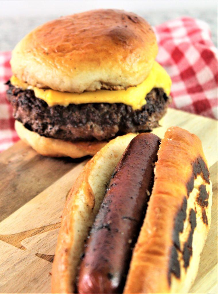 cheeseburger and hot dog on buns