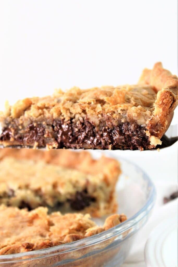 slice of chocolate chip pie being lifted out of pie