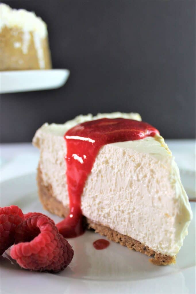 piece of cheesecake with raspberry sauce and raspberries