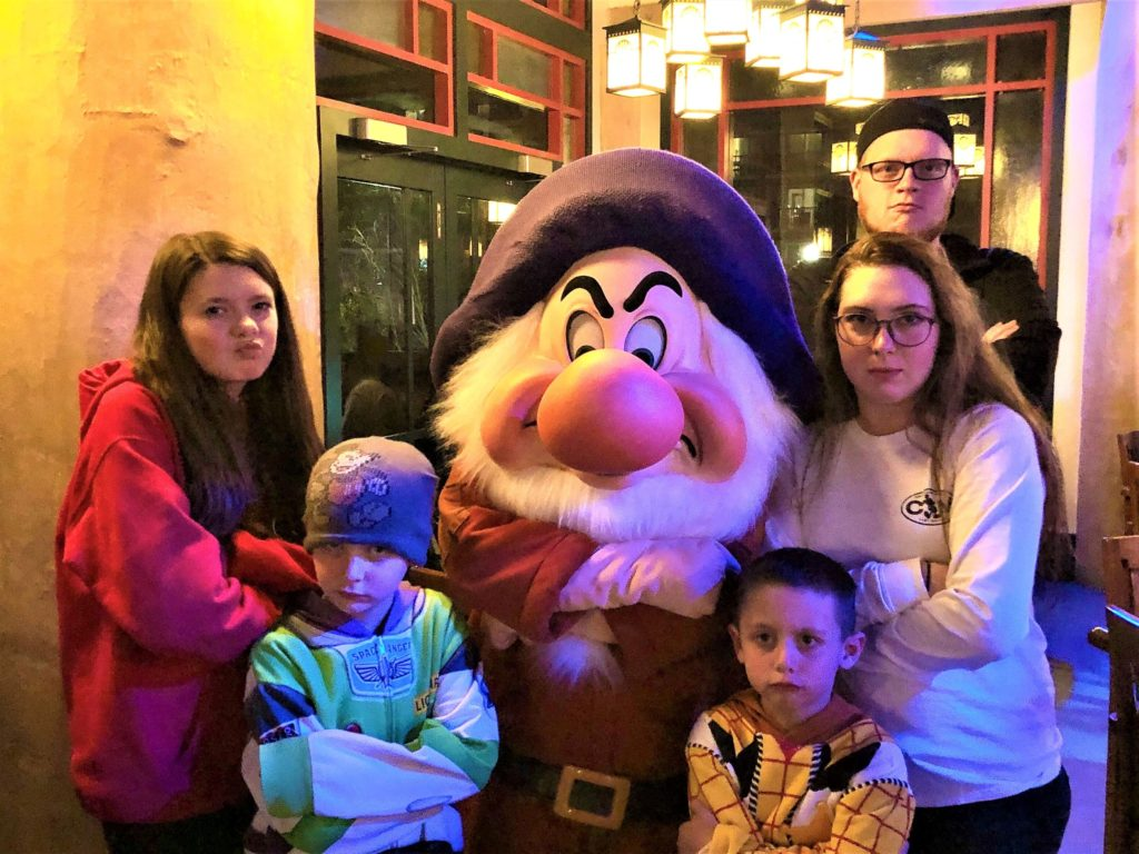 kids at storybook dining with grumpy