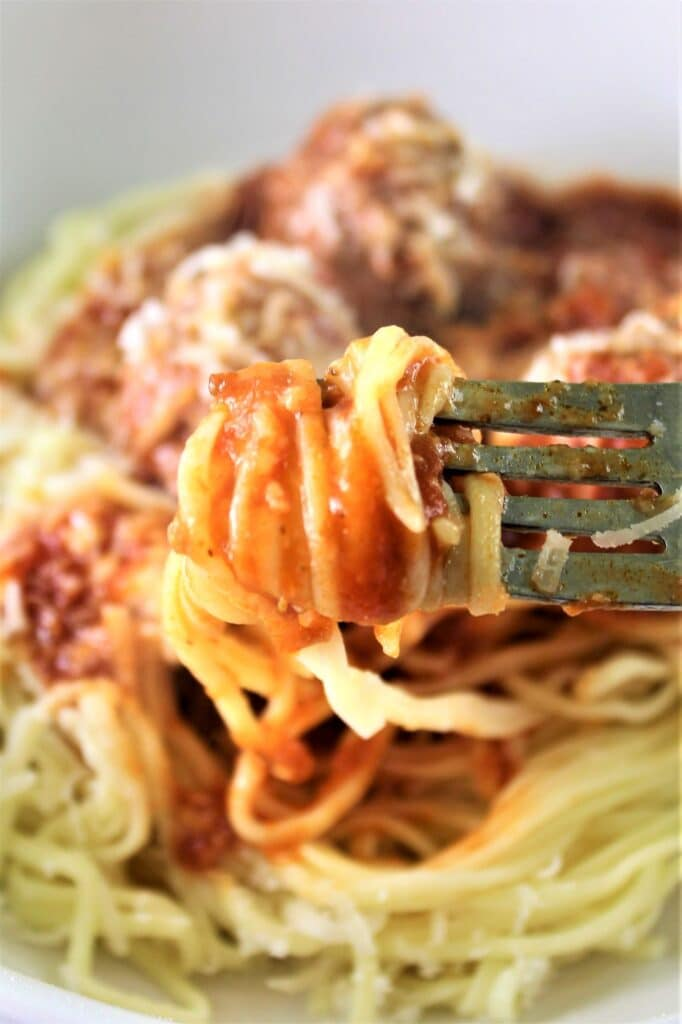 gluten free spaghetti and meatballs twirled on fork