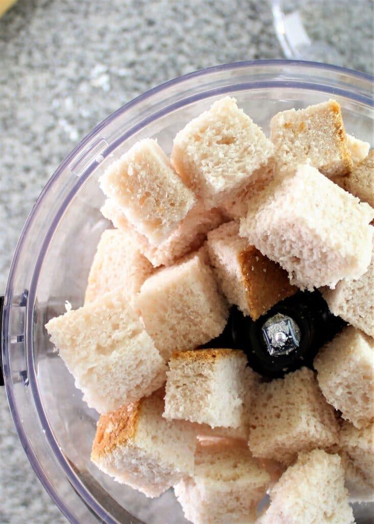 gluten free bread cubes in bowl of food processor