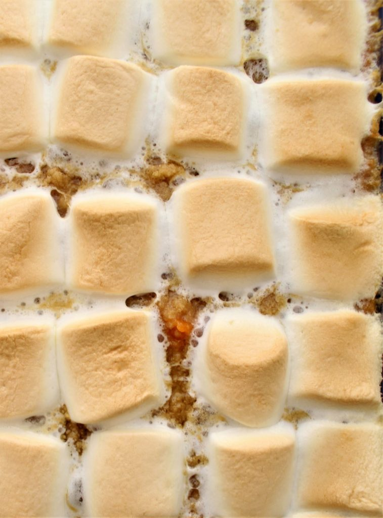 toasted marshmallows on top of sweet potatoes