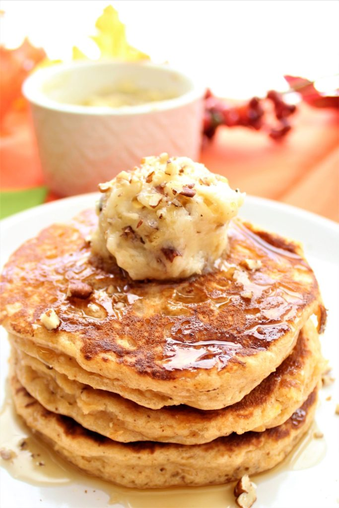 gluten free sweet potato pancakes on white plate with pecan honey butter
