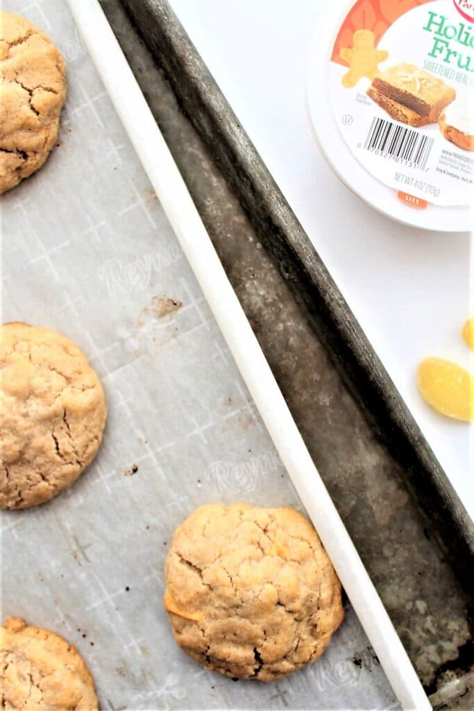 cookies on baking sheet with container of crystallized ginger