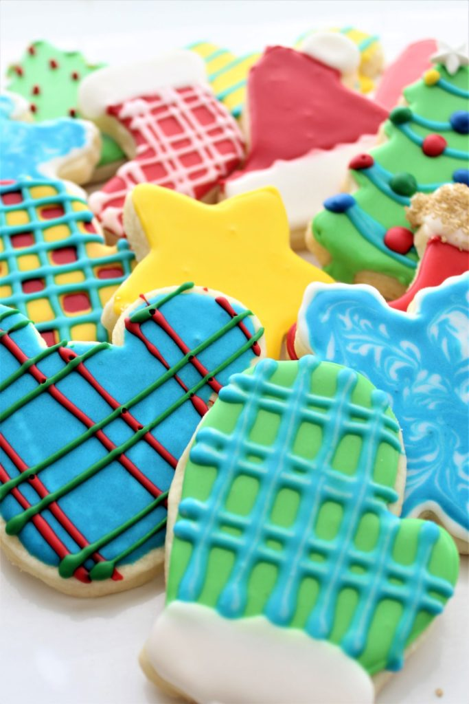 gluten free cutout sugar cookies in red, blue, green, and yellow colors