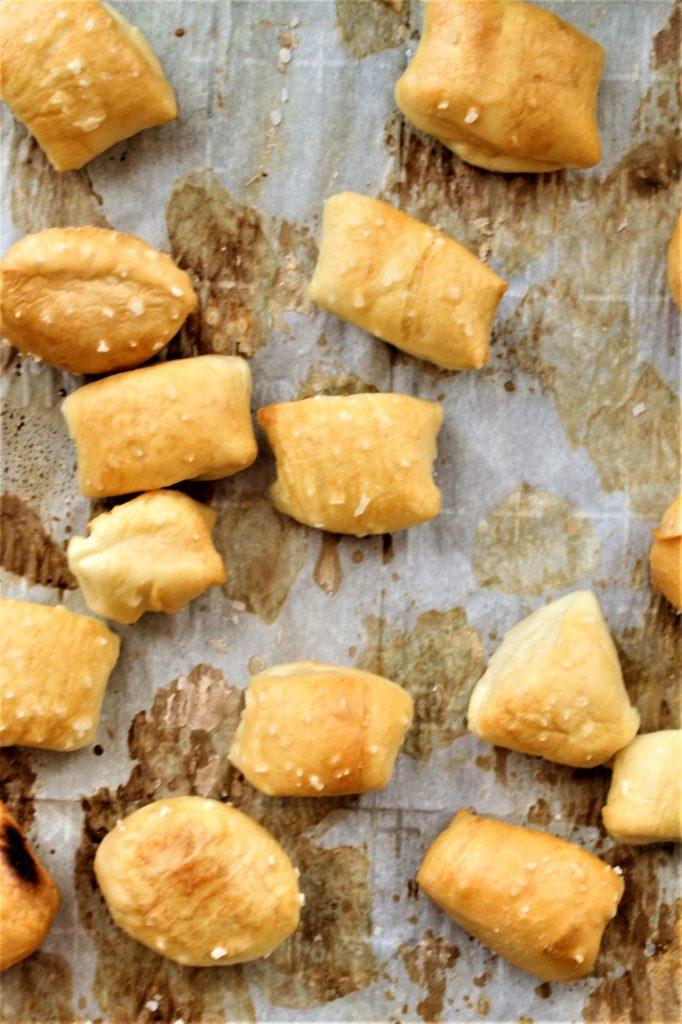 gluten free pretzel bites on parchment lined baking sheet