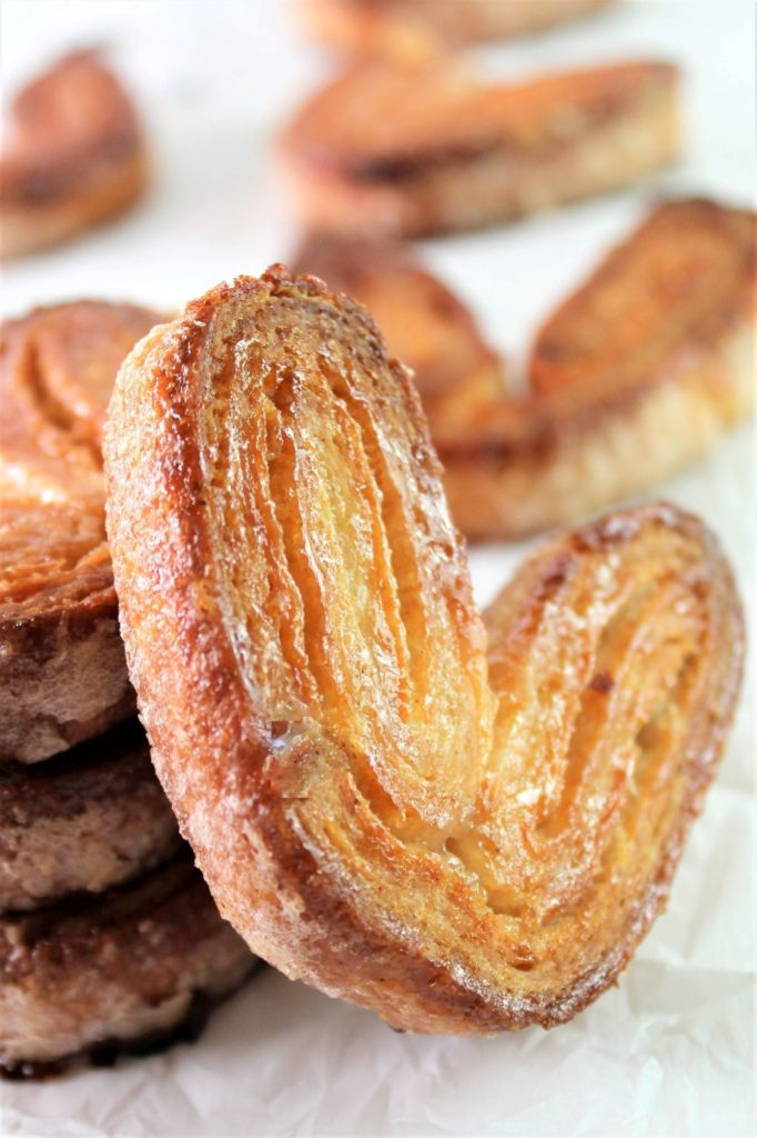 gf palmier resting on stack of other palmiers