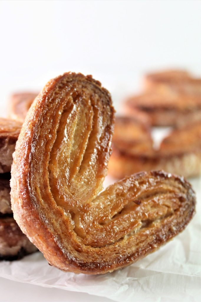 one palmier resting against a stack of palmier