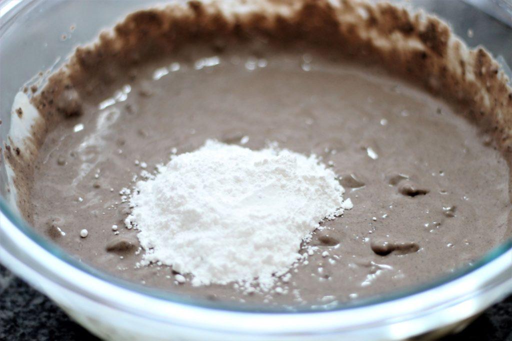 adding powdered sugar to whipped oreo mousse