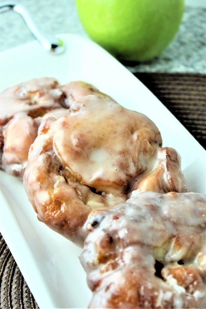 gluten free apple fritters on white platter