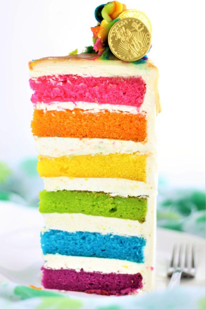 tall slice of rainbow cake