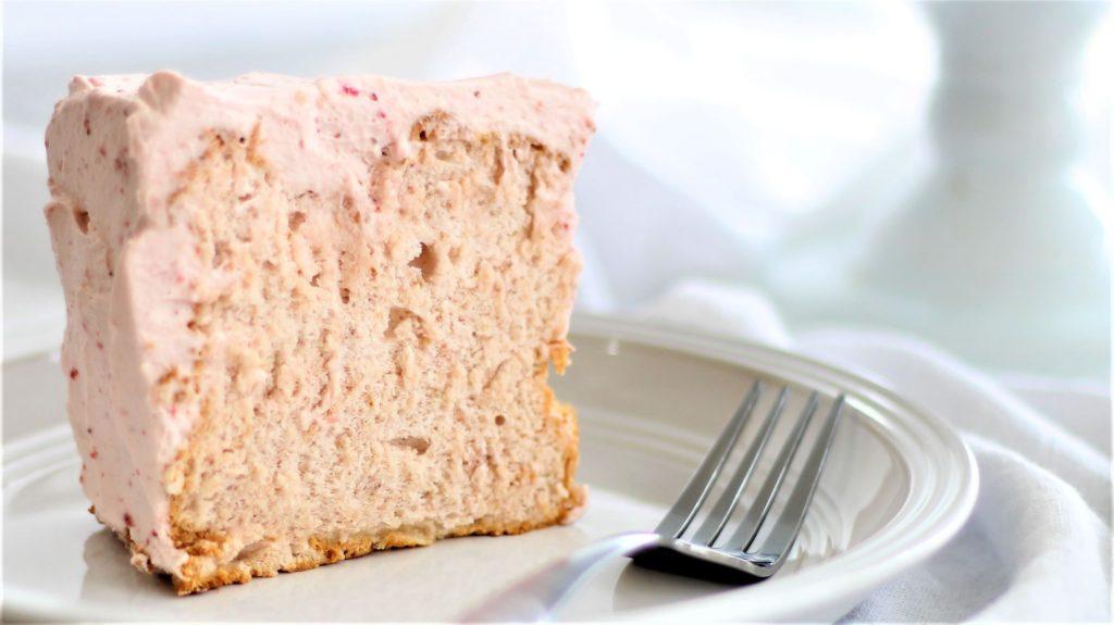 one slice of gf strawberry angel food cake on white plate
