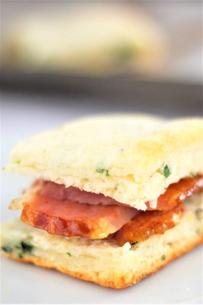 gluten free basil cream biscuit cut open with ham inside