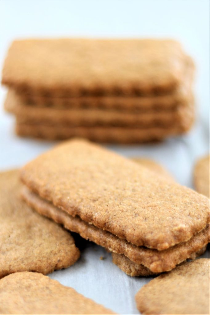 gluten free biscoff style cookies stacked on a tray