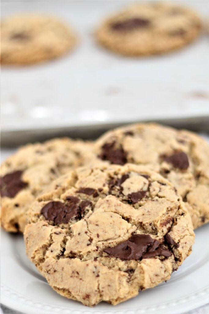 gluten free brown butter chocolate chunk cookies on white plate