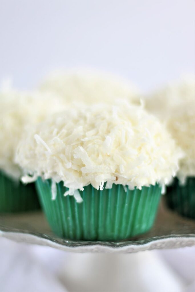 gluten free coconut cupcakes in green cupcake wrappers