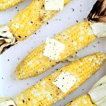 grilled corn on the cob with pats of butter