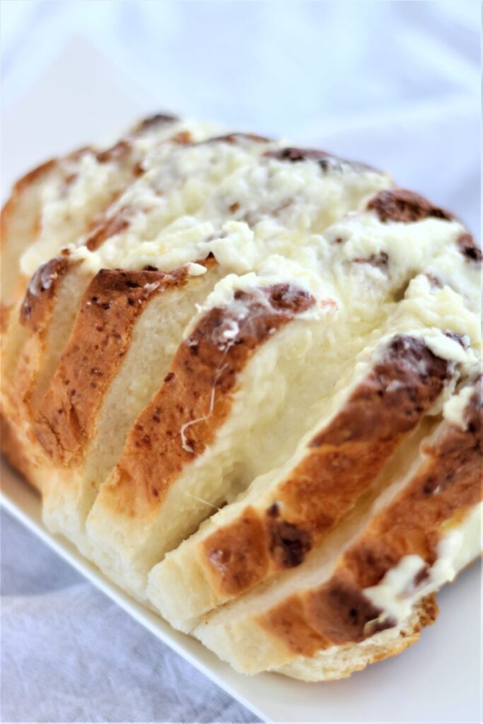 gluten free cheesy bread on white platter