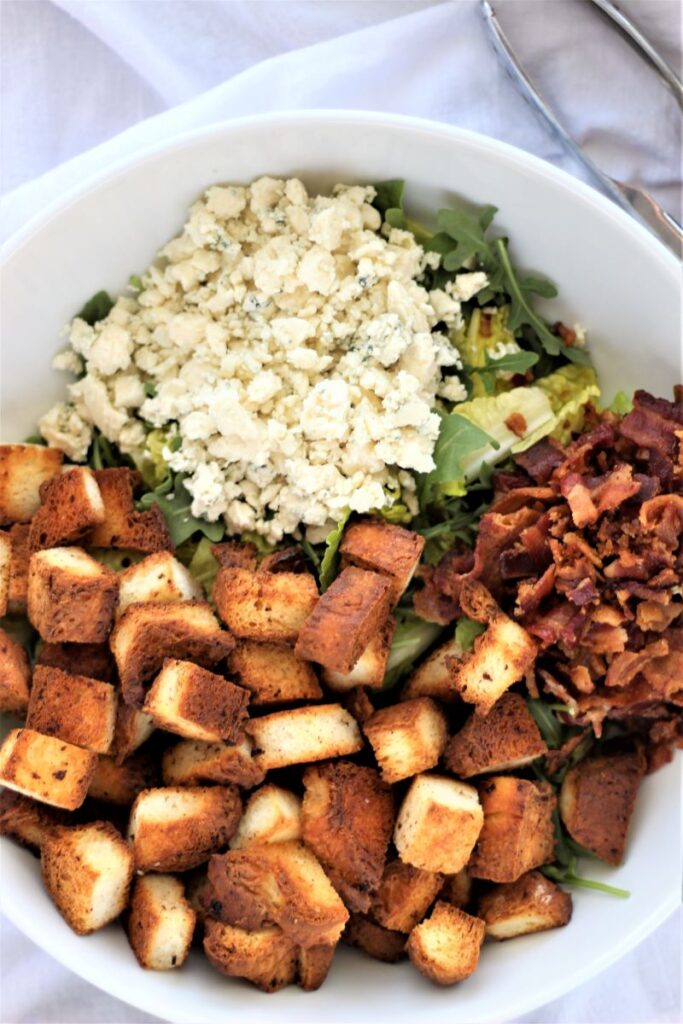 overhead shot of all components of the salad in a white bowl