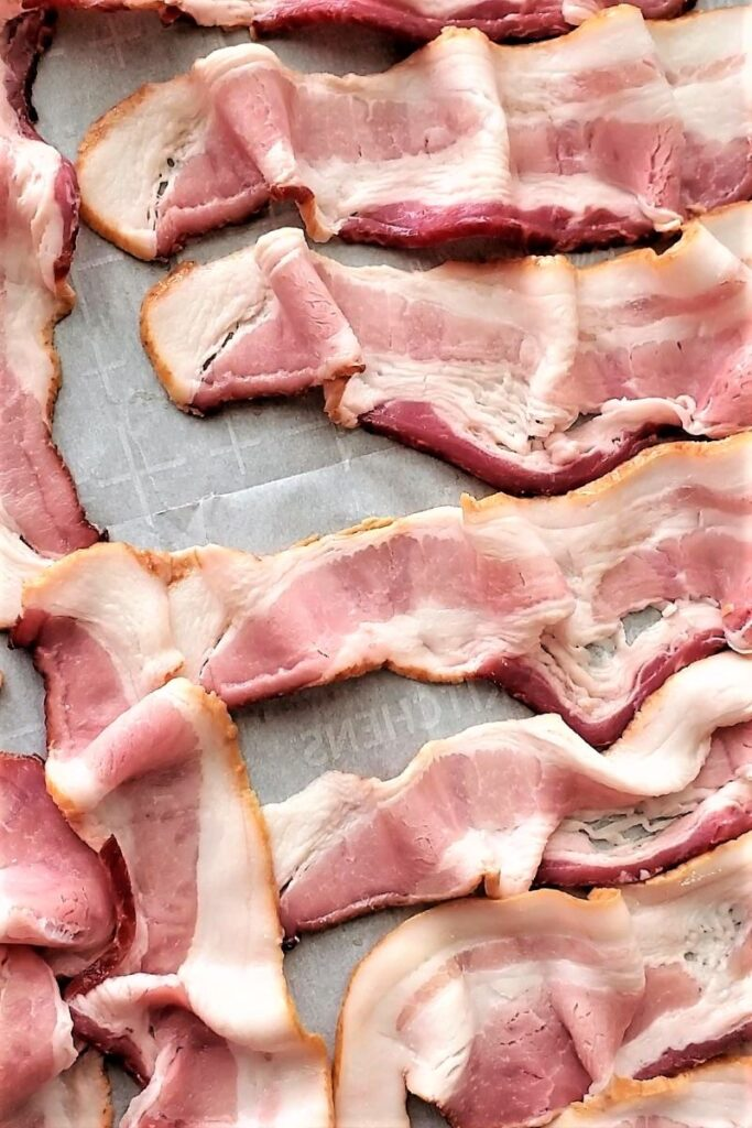 bacon on a parchment lined baking sheet