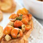 gluten free bruschetta on white platter