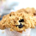 jumbo gluten free blueberry muffin on parchment paper