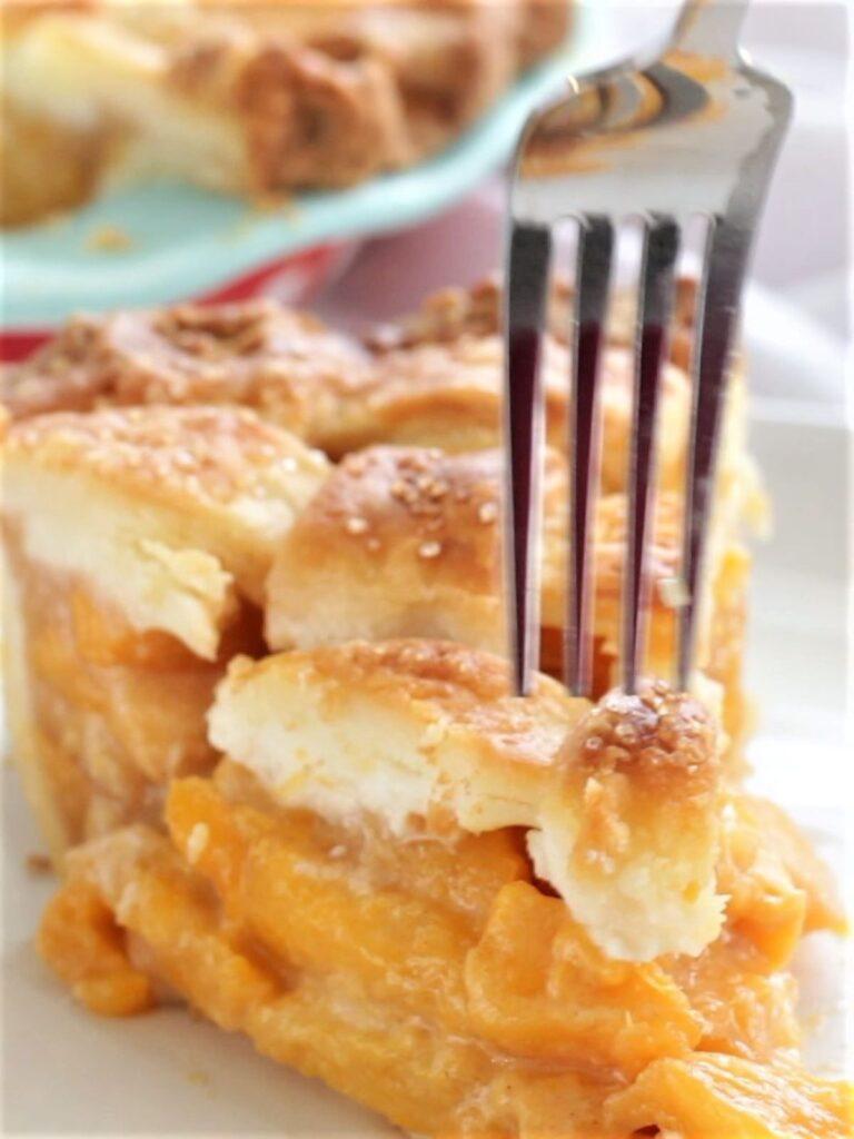 sticking fork into peach pie