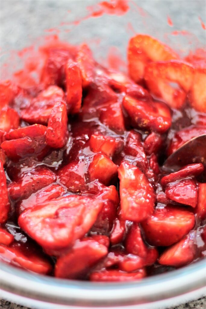 strawberries folded into strawberry and raspberry sauce