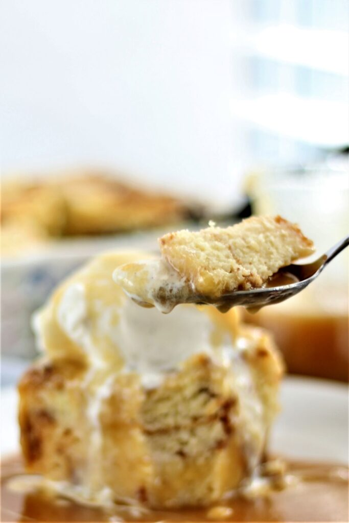 taking a bite of bread pudding on a spoon