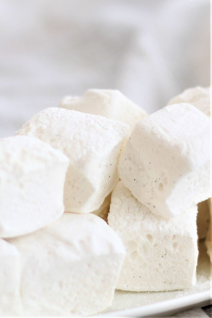 white plate stacked with homemade marshmallows